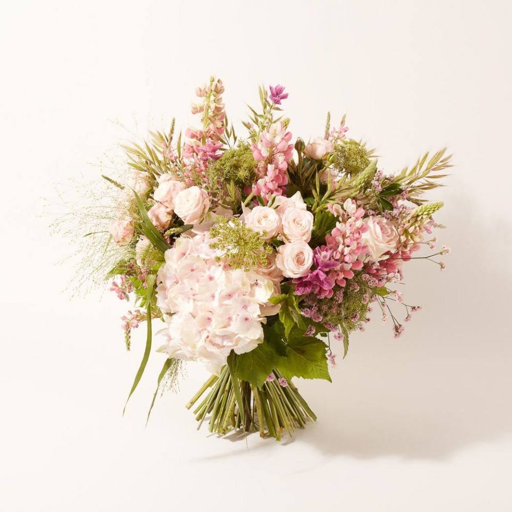 Bouquet of plants and seasonal flowers